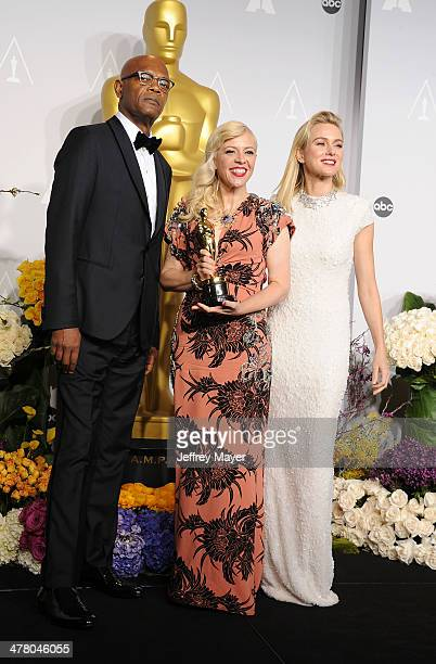 Actor Samuel L Jackson Costume Designer Catherine Martin and actress Naomi Watts pose in the press room during the 86th Annual Academy Awards at...