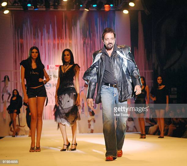 Actor Sanjay Dutt walks the runway in support of fellow actor Salman Khan's foundation 'Being Human' on the second day of the HDIL India Couture Week...