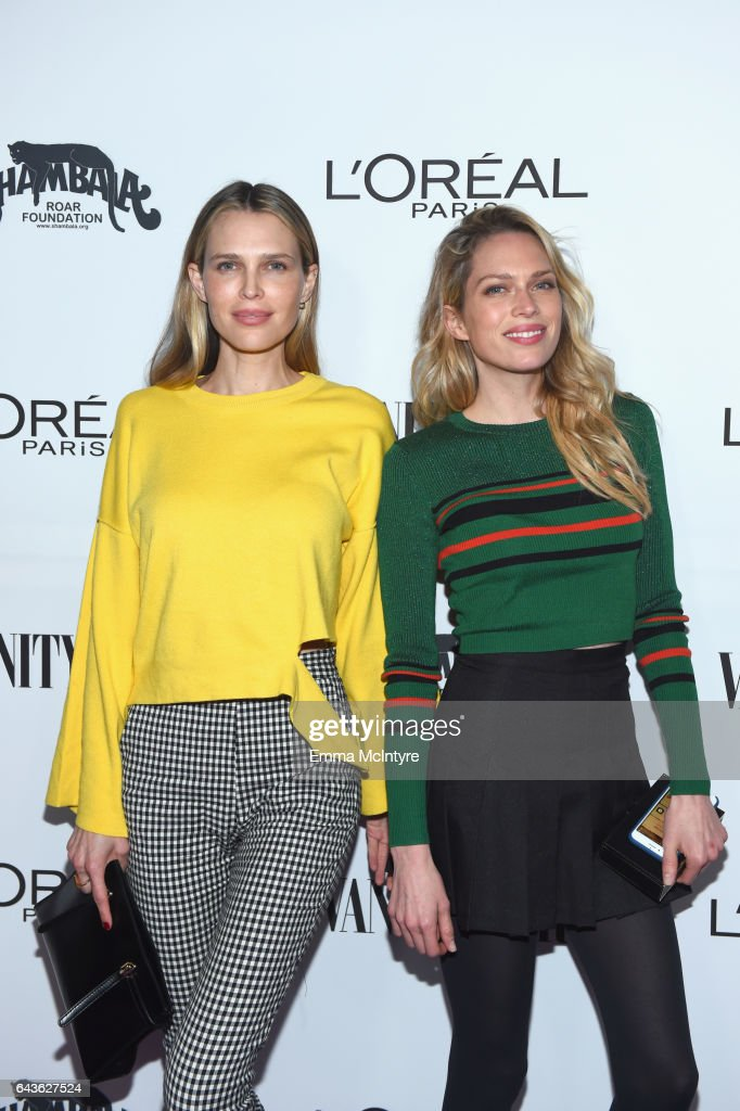 Actor Sara Foster (L) and Erin Foster attend Vanity Fair and L'Oreal Paris Toast to Young Hollywood hosted by Dakota Johnson and Krista Smith at Delilah on February 21, 2017 in West Hollywood, California.