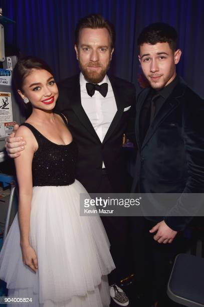 Actor Sarah Hyland actor Ewan McGregor and actorrecording artist Nick Jonas attend The 23rd Annual Critics' Choice Awards at Barker Hangar on January...