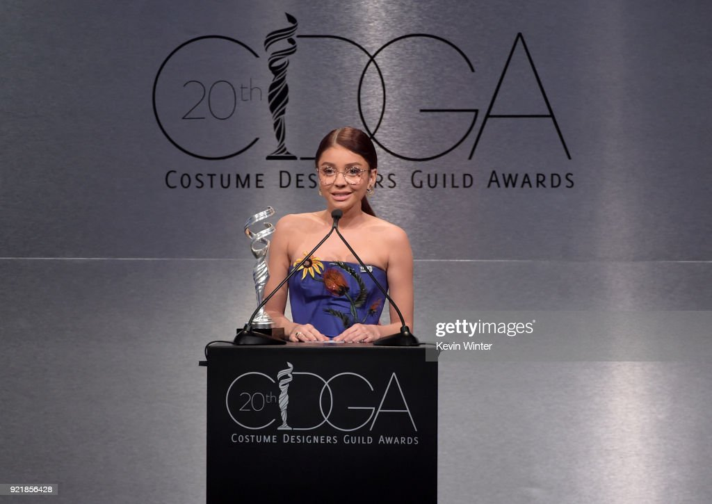 Actor Sarah Hyland speaks onstage during the Costume Designers Guild Awards at The Beverly Hilton Hotel on February 20, 2018 in Beverly Hills, California.