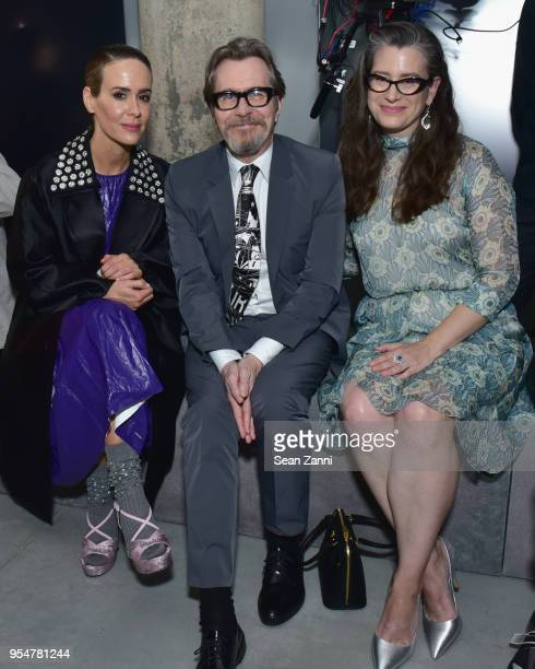 Actor Sarah Paulson Actor Gary Oldman and Giselle Schmidt attend the Prada Resort 2019 fashion show on May 4 2018 in New York City