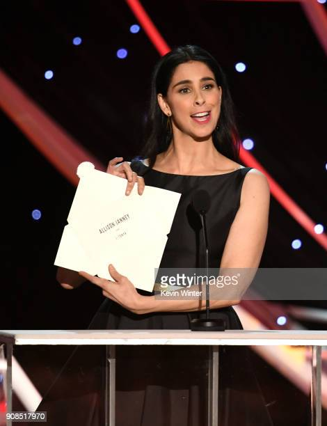 Actor Sarah Silverman displays an opened envelope announcing actor Allison Janney as winner of the Outstanding Performance by a Female Actor in a...