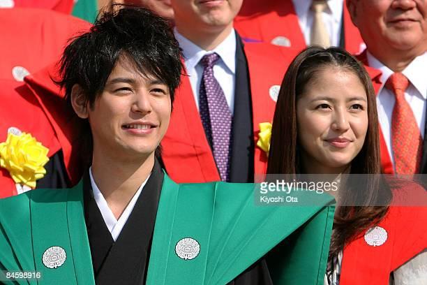 Actor Satoshi Tsumabuki and actress Masami Nagasawa attend a beanscattering ceremony at Shinshoji Temple on February 3 2009 in Narita Chiba Japan The...