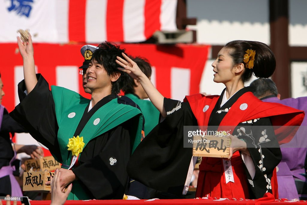Actor Satoshi Tsumabuki (L) and actress Takako Tokiwa throw packs of beans during a bean-scattering ceremony at Shinshoji Temple on February 3, 2009 in Narita, Chiba, Japan. The ceremony is held all over Japan on Setsubun which is the name of the day before the beginning of each season, which in this case is on February 3 or 4, one day before the start of spring according to the Japanese lunar calendar. It has been said that throwing beans drives out misfortune and brings in good luck.