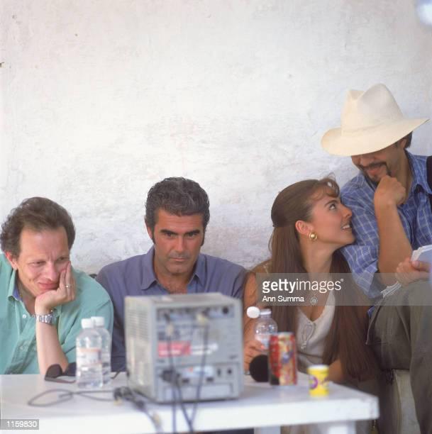 Actor Saul Lizaso watches TV with producer Carlos Sotomayor actress Kate del Castillo and director Sergio Catano taken in August 2000 in Cuernavaca...