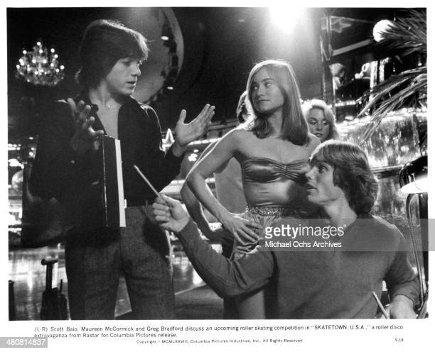 Actor Scott Baio actress Maureen McCormick and actor Greg Bradford in a scene from the movie Skatetown USA circa 1979
