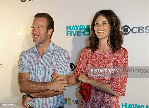 Actor Scott Caan and Kacy Byxbee speak with the media as they arrive at the CBS 'Hawaii Five0' Sunset On The Beach Season 7 Premier Event at Queen's...