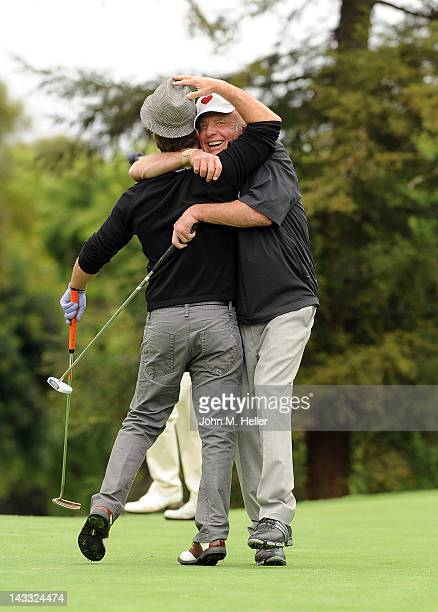Actor Scott Caan give his father actor James Caan a hug after making an eagle on the eighth hole at the 9th Annual James Caan Golf Classic at the El...