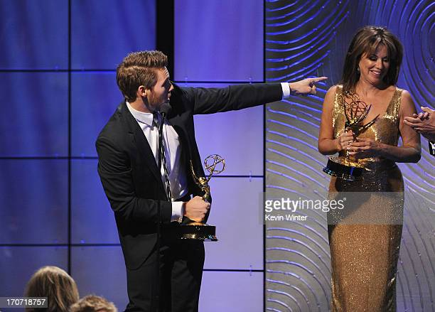 """Actor Scott Clifton accepts the Outstanding Supporting Actor in a Drama Series award for """"The Bold and the Beautiful"""" from presenter Nancy Lee Grahn..."""