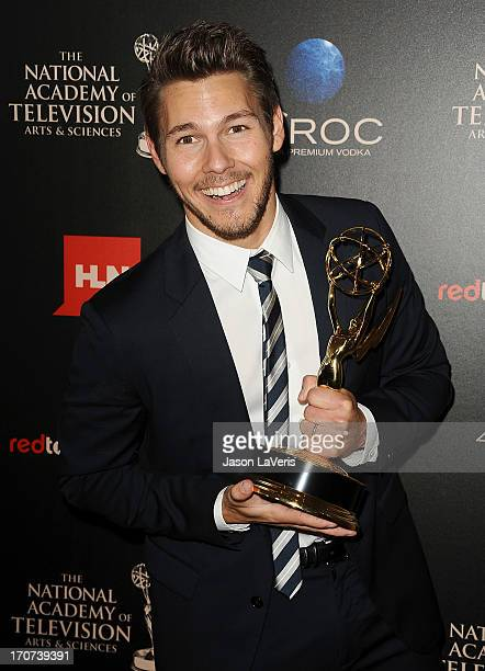 Actor Scott Clifton poses in the press room at the 40th annual Daytime Emmy Awards at The Beverly Hilton Hotel on June 16 2013 in Beverly Hills...
