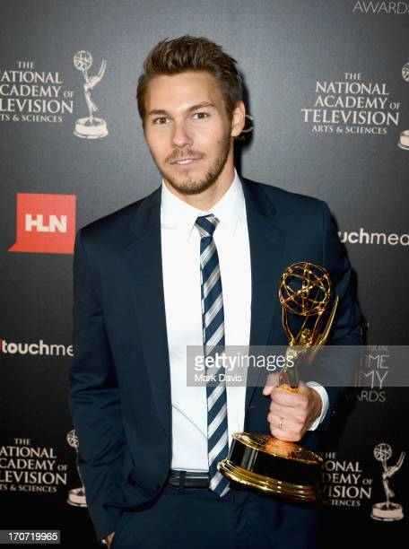 Actor Scott Clifton poses with the Outstanding Supporting Actor in a Drama Series award for 'The Young and the Restless' in the press room during The...