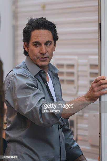 Actor Scott Cohen enters his trailer at the 'Carrie Diaries' movie set in Midtown Manhattan on August 15 2013 in New York City