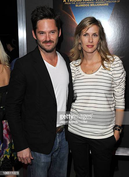 Actor Scott Cooper and wife Jocelyne Cooper arrive at the premiere of 127 Hours at the Academy Of Motion Picture Arts and Sciences Samuel Goldwyn...