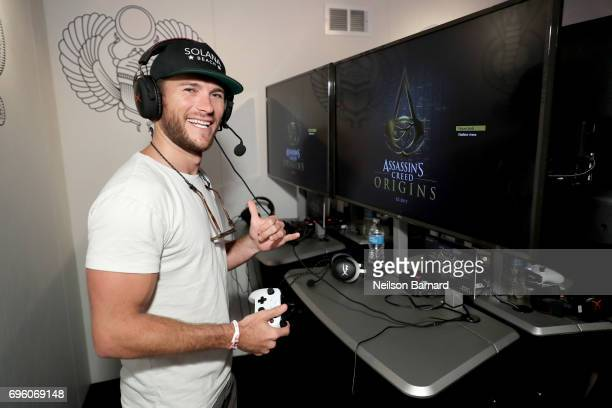 Actor Scott Eastwood plays Assassin's Creed Origins during Ubisoft E3 2017 at Los Angeles Convention Center on June 14 2017 in Los Angeles California