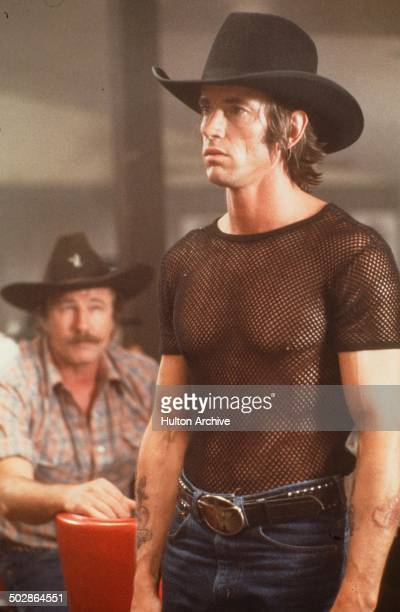 Actor Scott Glenn stands in a scene during the Paramount Pictures movie 'Urban Cowboy circa 1980