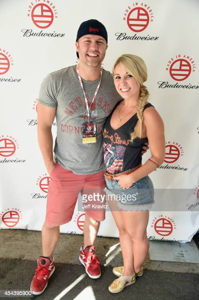 Actor Scott Porter and Kelsey Mayfield pose backstage during day 1 of the 2014 Budweiser Made In America Festival at Los Angeles Grand Park on August...