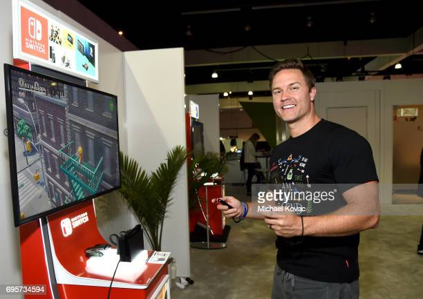 Actor Scott Porter plays Super Mario Odyssey at the Nintendo booth at the 2017 E3 Gaming Convention at Los Angeles Convention Center on June 13, 2017...