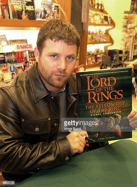 Actor Sean Astin holds a copy of The Lord of the Rings Visual Companion during a promotional event for the upcoming film of the same name November 8...