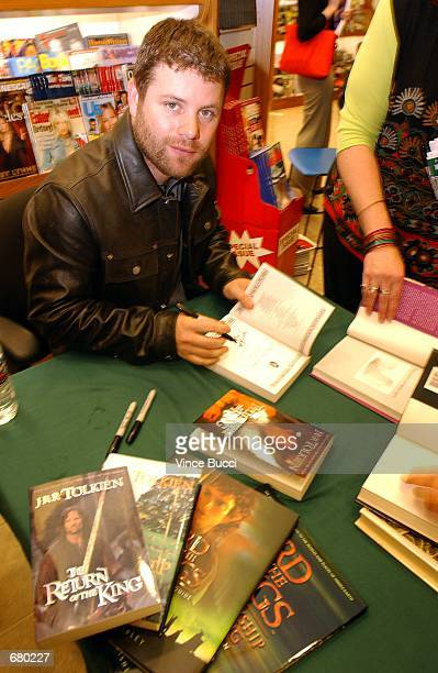 Actor Sean Astin signs autographs in books including the 'Lord of the Rings' Visual Companion during a promotional event for the upcoming film of the...
