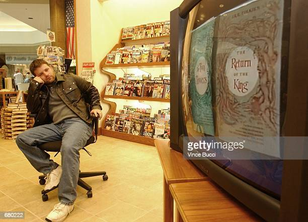 Actor Sean Astin watches a monitor displaying a short documentary on the making of the film The Lord of the Rings November 8 2001 at Brentano's...