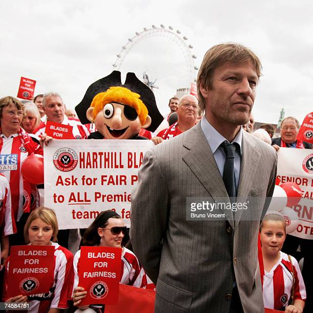 Actor Sean Bean poses with Sheffield United fans on the Embankment on June 13 2007 in London Bean is visiting Westminister Palace to speak with MP's...