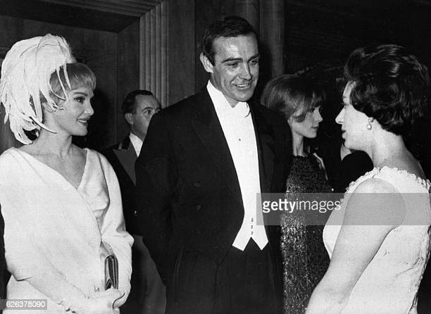 Actor Sean Connery and his wife American actress Diane Cilento are presented to Princess Margaret 15 February 1965 during the Royal Film Performance...