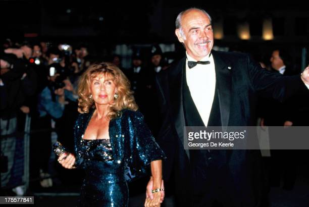 Actor Sean Connery and his wife Micheline Roquebrune attend the premiere of 'The Hunt for Red October' at Odeon cinema on April 18 1990 in London...