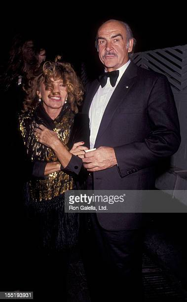 Actor Sean Connery and wife Micheline Connery attend New Year's Eve Party on December 31 1990 at Spago Restaurant in West Hollywood California