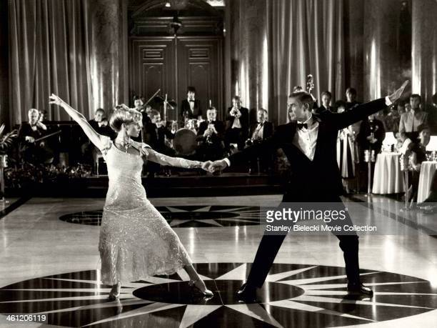 Actor Sean Connery as James Bond, dancing with actress Kim Basinger, in a scene from the film 'Never Say Never Again', 1983.