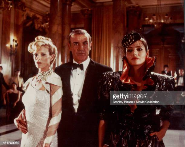 Actor Sean Connery as James Bond, with 'Bond girls' Kim Basinger and Barbara Carrera, in a scene from the film 'Never Say Never Again', 1983.