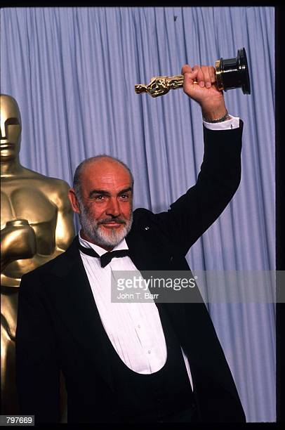 Actor Sean Connery holds up his Best Actor in a Supporting Role Oscar for 'The Untouchables' at the Academy Awards April 11 1988 in Los Angeles CA...
