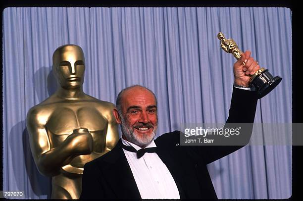 "Actor Sean Connery holds up his Best Actor in a Supporting Role Oscar for ""The Untouchables"" at the Academy Awards April 11, 1988 in Los Angeles, CA...."