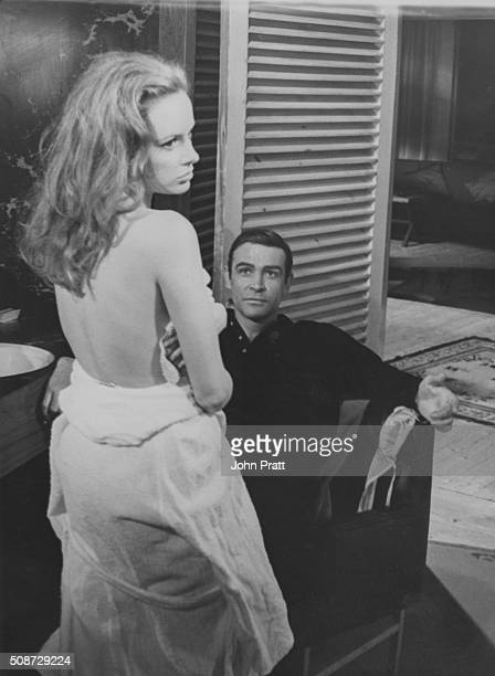 Actor Sean Connery watching actress Luciana Paluzzi wearing nothing but a towel, in a scene from the James Bond film 'Thunderball', March 16th 1965.