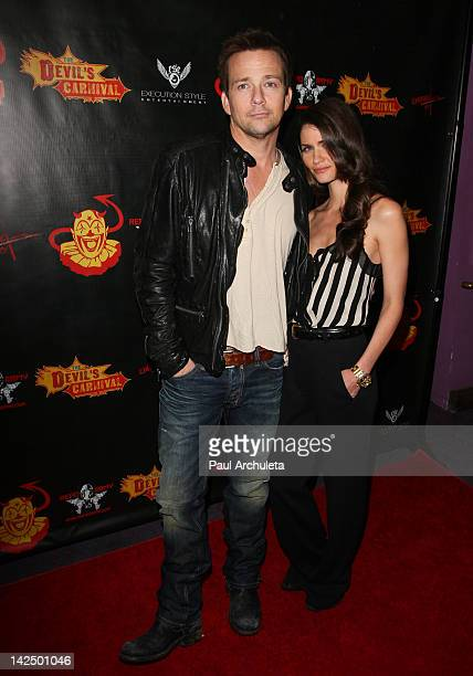 Actor Sean Patrick Flanery and his wife Playboy Playmate Lauren Michelle Hill attend The Devil's Carnival Los Angeles premiere at the Laemmle's Royal...