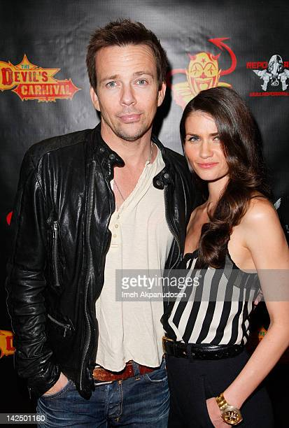 Actor Sean Patrick Flanery and Playmate Lauren Michelle Hill attend the premiere of 'The Devil's Carnival' at Laemmle's Royal Theatre on April 5 2012...