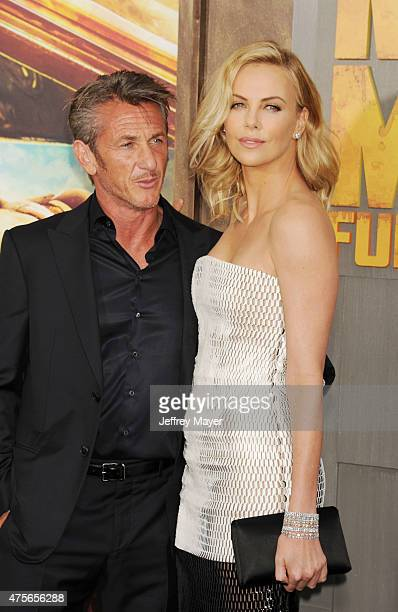 Actor Sean Penn and actress Charlize Theron arrive at the Mad Max Fury Road Los Angeles Premiere at TCL Chinese Theatre IMAX on May 7 2015 in...