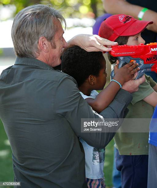 Actor Sean Penn and Jackson Theron attend the Points of Light generationOn Block Party on April 18 2015 in Los Angeles California