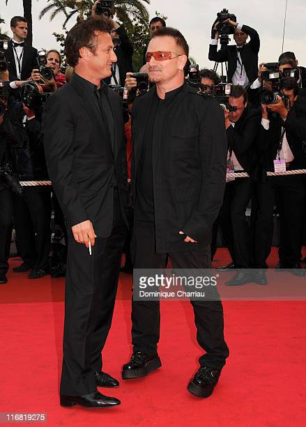 """Actor Sean Penn and singer Bono of U2 walk the red carpet in support of the Presidential Screening of the documentary """"The Third Wave"""" while arriving..."""