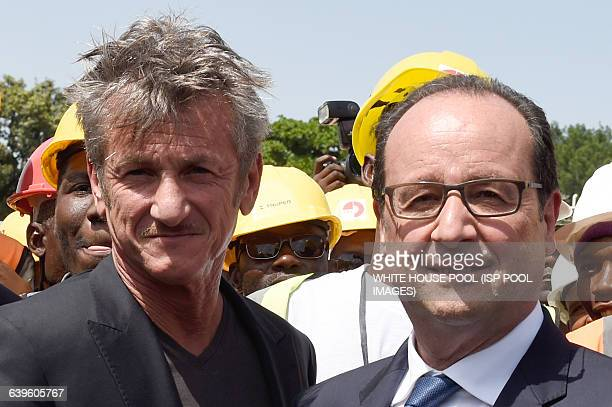 US actor Sean Penn CEO of the J/P Haitian relief Organization and French president Francois Hollande pose for a picture as they tour the site of the...