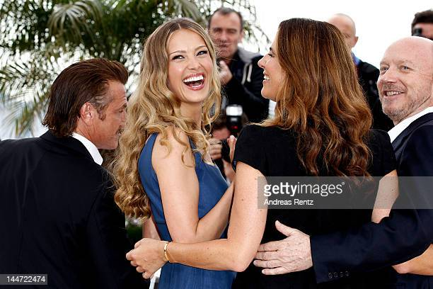 Actor Sean Penn model Petra Nemcova Roberta Armani and writer Paul Haggis pose at the 'Haiti Carnaval In Cannes' photocall during the 65th Annual...