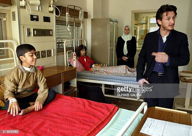 US actor Sean Penn visits alMansour children hospital in Baghdad 13 December 2002 Penn who is on a threeday visit in Iraq said that he wanted more...