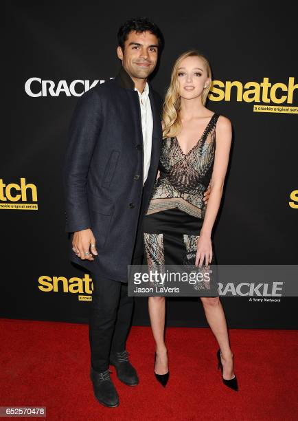 Actor Sean Teale and actress Phoebe Dynevor attend the premiere of Snatch at Arclight Cinemas Culver City on March 9 2017 in Culver City California