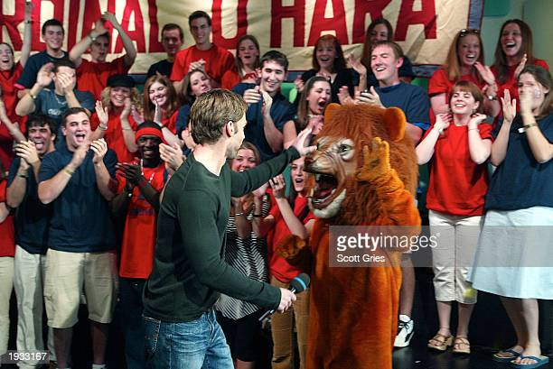 Actor Seann William Scott gives a high five to the mascot from Cardinal O'Hara High School during 'TRL High School Week' on MTV at the MTV Times...
