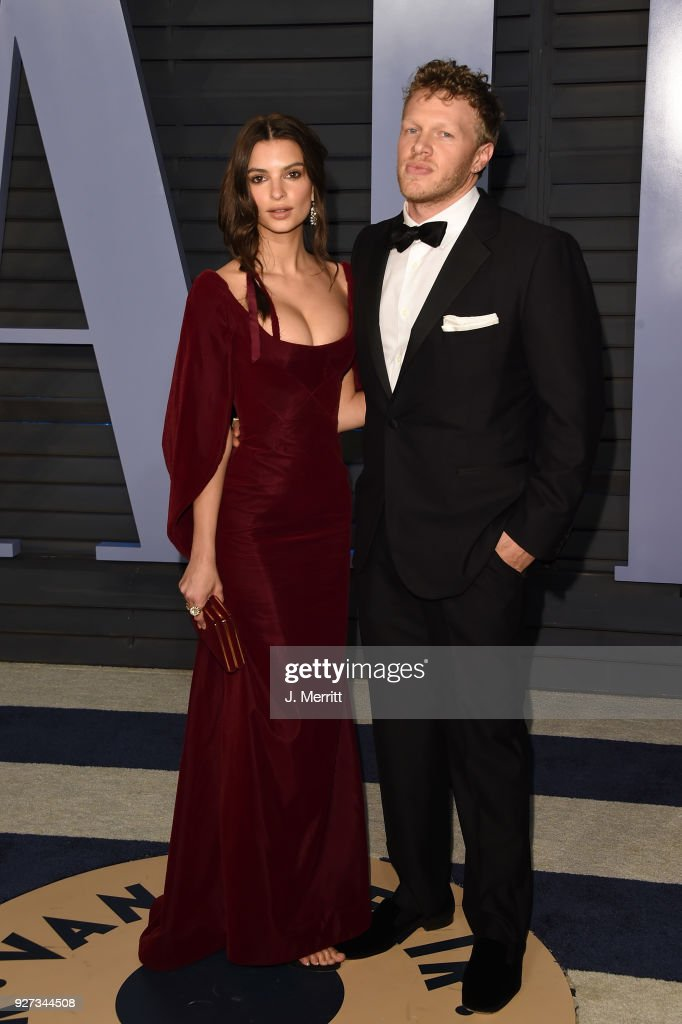 Actor Sebastian Bear-McClard (L) and actress Emily Ratajkowski attend the 2018 Vanity Fair Oscar Party hosted by Radhika Jones at the Wallis Annenberg Center for the Performing Arts on March 4, 2018 in Beverly Hills, California.