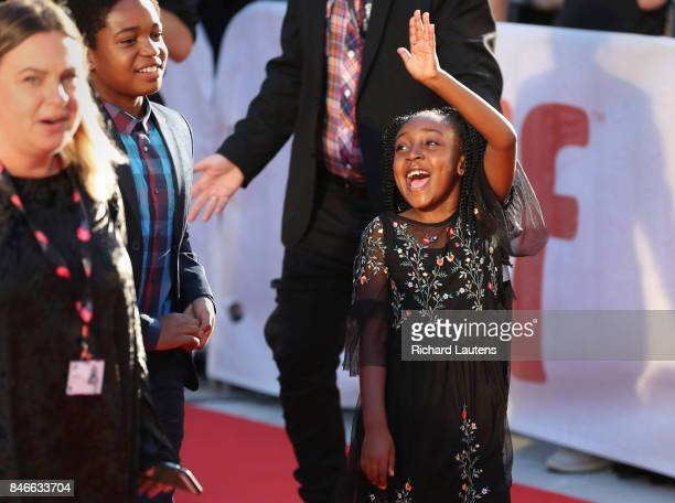 TORONTO ON SEPTEMBER 13 actor Serenety Brown waves to the crowd Movie Kings held a red carpet before the screening at Roy Thomson Hall for TIFF...