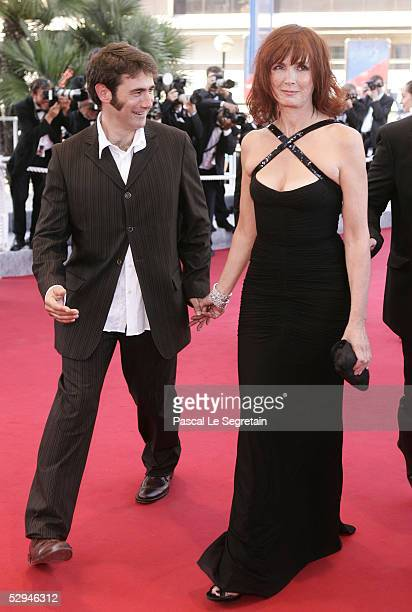 Actor Sergi Lopez and Actresses Sabine Azema pose as they arrive at the screening of Peindre Ou Faire L'Amour at the Palais during the 58th...