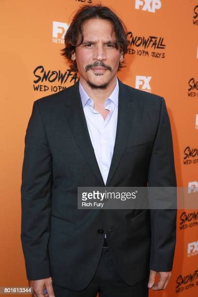 Actor Sergio PerisMencheta attends the premiere of FX's Snowfall at The Theatre at Ace Hotel on June 26 2017 in Los Angeles California