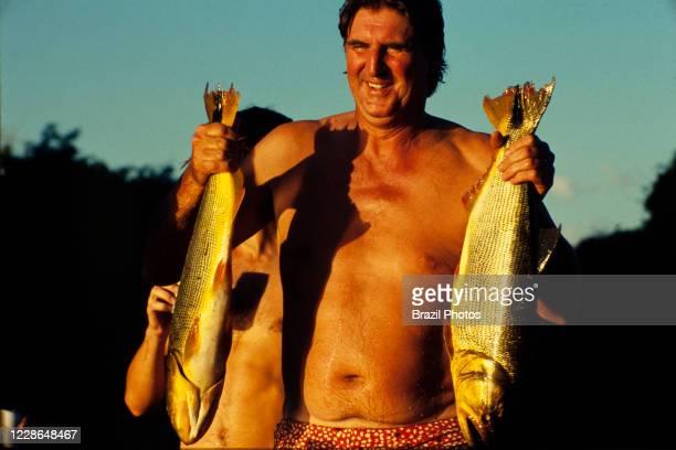 Actor Sergio Reis fishes dourado during a break on the recordings of Pantanal, Brazilian telenovela TV serial drama , soap opera - originally aired...