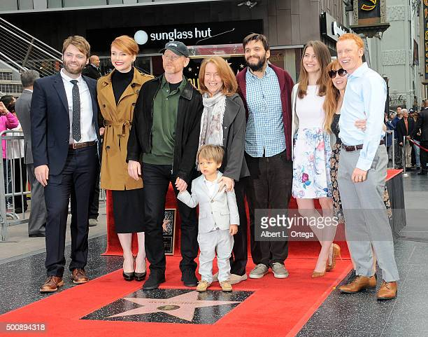 Actor Seth Gabel actress Bryce Dallas Howard director/father Ron Howard and mother Cheryl Howard at the Ron Howard Star ceremony on The Hollywood...